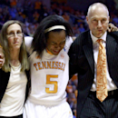 Tennessee guard Ariel Massengale (5) is helped from the court by assistant coach Dean Lockwood, right, and trainer Jenny Moshak in the second half of an NCAA college basketball game against Texas A&M, Thursday, Feb. 28, 2013, in Knoxville, Tenn. Tennessee won 82-72 to clinch its 17th Southeastern Conference regular-season title outright. (AP Photo/Wade Payne)