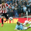 Sunderland's Marcos Alonso, left, vies for the ball with Manchester City's Pablo Zabaleta, right, during their English League Cup final soccer match at Wembley Stadium, London, England, Sunday, March 2, 2014