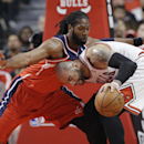 Washington Wizards forward Nene, left, guards Chicago Bulls forward Carlos Boozer during the first half in Game 1 of an opening-round NBA basketball playoff series in Chicago, Sunday, April 20, 2014 The Associated Press