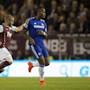 Chelsea's Didier Drogba, centre, keeps the ball from Burnley's Michael Kightly during their English Premier League soccer match at Turf Moor Stadium, Burnley, England, Monday Aug. 18, 2014