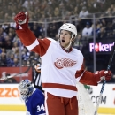 Detroit Red Wings' Justin Abdelkader celebrates after scoring against Toronto Maple Leafs goalie James Reimer (34) during third-period NHL hockey game action in Toronto, Friday, Oct. 17, 2014 The Associated Press