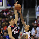 Los Angeles Clippers forward Matt Barnes (22) has his shot blocked by Atlanta Hawks guard Kyle Korver (26) in the second half of an NBA basketball game, Saturday, March 8, 2014, in Los Angeles. The Clippers won 109-108 The Associated Press