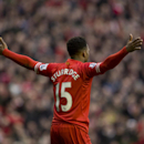 Liverpool's Daniel Sturridge celebrates after scoring against Swansea City during their English Premier League soccer match at Anfield Stadium, Liverpool, England, Sunday Feb. 23, 2014