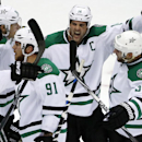 Dallas Stars' Jamie Benn (14) celebrates with teammates after getting the tying goal during the third period of an NHL hockey game against the Pittsburgh Penguins in Pittsburgh, Thursday, Oct. 16, 2014. The Stars won 3-2 The Associated Press