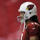 Arizona Cardinals' Larry Fitzgerald watches drills during NFL football practice, Thursday, Sept. 18, 2014, at the teams' training facility in Tempe, Ariz. It was the first day of practice after running back Jonathan Dwyer was arrested on aggravated assaul