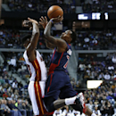 Detroit Pistons point guard Brandon Jennings (7) is fouled by Miami Heat point guard Norris Cole (30) in the second quarter of an NBA basketball game in Auburn Hills, Mich., Sunday, Dec. 8, 2013 The Associated Press