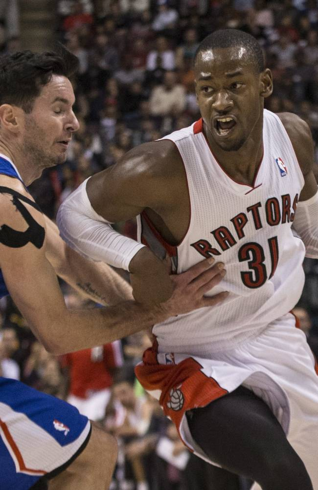 Toronto Raptors' Terrence Ross, (31) drives past Los Angeles Clippers' J.J. Redick during the second half of an NBA basketball game, Saturday, Jan. 25, 2014 in Toronto
