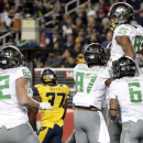 Oregon tight end Pharaoh Brown, top right, is lifted by teammates after his touchdown reception against California during the first half of an NCAA college football game Friday, Oct. 24, 2014, in Santa Clara, Calif The Associated Press
