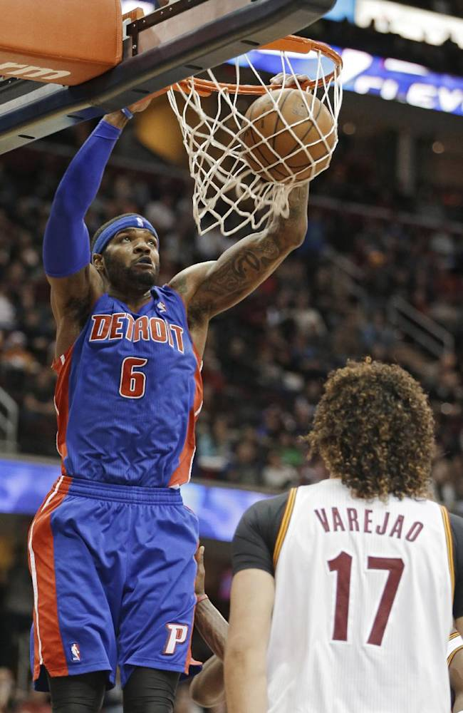 Detroit Pistons' Josh Smith (6) dunks in front of Cleveland Cavaliers' Anderson Varejao (17), from Brazil, during the third quarter of an NBA basketball game Monday, Dec. 23, 2013, in Cleveland. Smith led the Pistons with 25 points in a 115-92 win over the Cavaliers