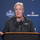 Seattle Seahawks head coach Pete Carroll talks with reporters during a news conference at the NFL football scouting combine at Lucas Oil Stadium in Indianapolis, Friday, Feb. 20, 2015. (AP Photo/Doug McSchooler)