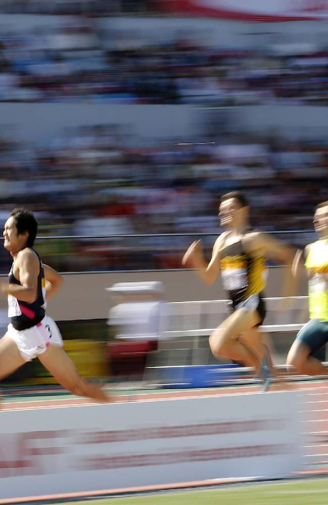 Runners from left to right; Winner Sho Kawamoto of Japan, Giordano Benedetti of Italy, Erik Sowinski of the United States and Edwin Kiplagat Melly of Kenya run during the men's 800-meter race at the Golden Grand Prix track and field in Tokyo, Sunday, May 11, 2014