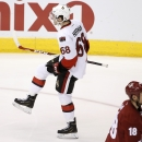 Ottawa Senators' Mike Hoffman (68) celebrates his goal against the Arizona Coyotes as Coyotes' David Moss (18) skates past during the second period of an NHL hockey game Saturday, Jan. 10, 2015, in Glendale, Ariz The Associated Press