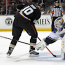 St. Louis Blues goalie Brian Elliott (1) stops a shot by Anaheim Ducks right wing Corey Perry (10) with help from defenseman Kevin Shattenkirk during the second period of an NHL hockey game on Friday, Feb. 28, 2014, in Anaheim, Calif The Associated Press