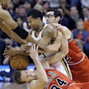 Utah Jazz's Trey Burke, center, battles for a loose ball against Chicago Bulls' Mike Dunleavy (34) and teammates Kirk Hinrich, right, in overtime during an NBA basketball game Monday, Nov. 25, 2013, in Salt Lake City. The Jazz won 89-83 The Associated Pre
