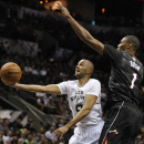 San Antonio Spurs guard Tony Parker, left, of France, shoots against Miami Heat forward Chris Bosh during the first half of an NBA basketball game on Thursday, March 6, 2014, in San Antonio The Associated Press
