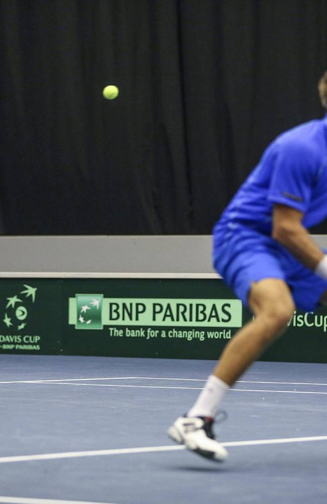 Sweden's Johan Brunstrom, left, returns the ball with Robert Lindstedt, right, during their doubles match of the second round of the Davis Cup Europe/Africa Zone between Sweden and Ukraine in Baltiska Hallen in Malmo, Sweden,  Saturday April 5, 2014. (AP photo TT News Agency / Andreas Hillergren)