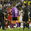 Real Madrid's coach Carlo Ancelotti, left, walks over to greet the match officials after the Champions League group B soccer match between Liverpool and Real Madrid at Anfield Stadium, Liverpool, England, Wednesday Oct. 22, 2014. Real won the match 3-0
