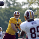 Washington Redskins quarterback Colt McCoy passes the ball to receiver Santana Moss during practice at the team's NFL football training facility, Saturday, July 26, 2014 in Richmond, Va The Associated Press