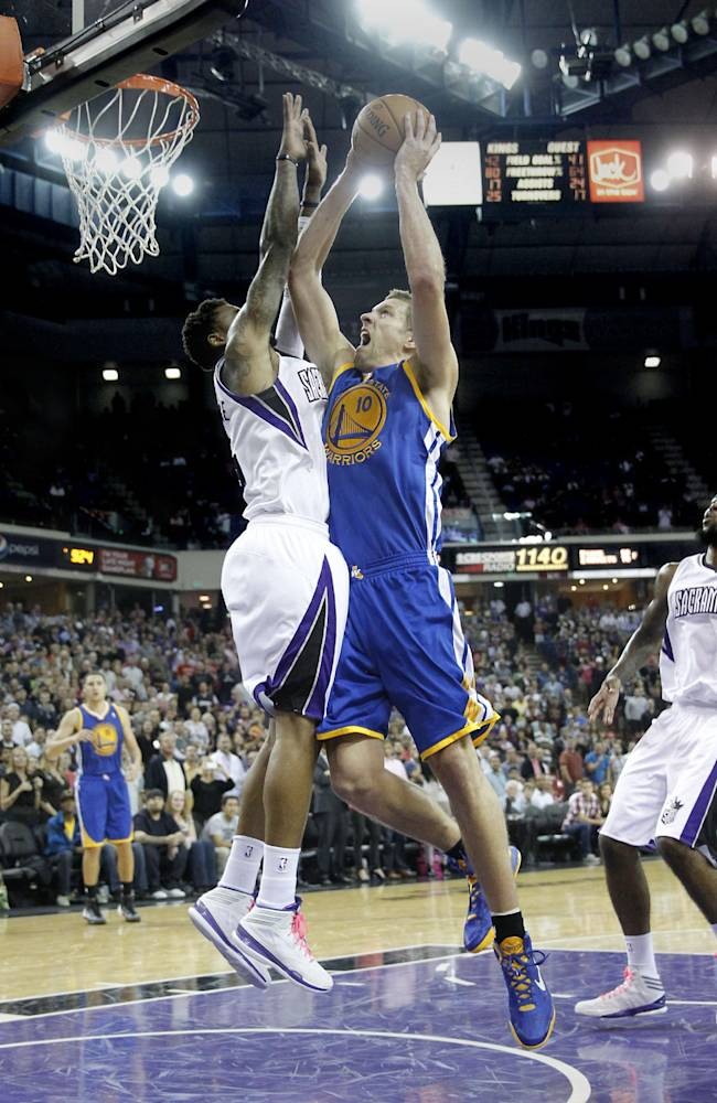 Golden State Warriors forward David Lee, right, is fouled by Sacramento Kings guard Ben McLemore during the closing moments of an NBA preseason basketball game in Sacramento, Calif., Wednesday, Oct. 23, 2013.  Lee missed the first of two free throws that would have tied the game and the Kings went on to win 91-90