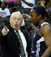 Connecticut Sun head coach Mike Thibault, left, speaks to Sun guard Danielle McCray during a WNBA basketball game against the New York Liberty at the Prudential Center, Thursday, Aug. 16, 2012, in Newark, N.J. (AP Photo/John Minchillo)