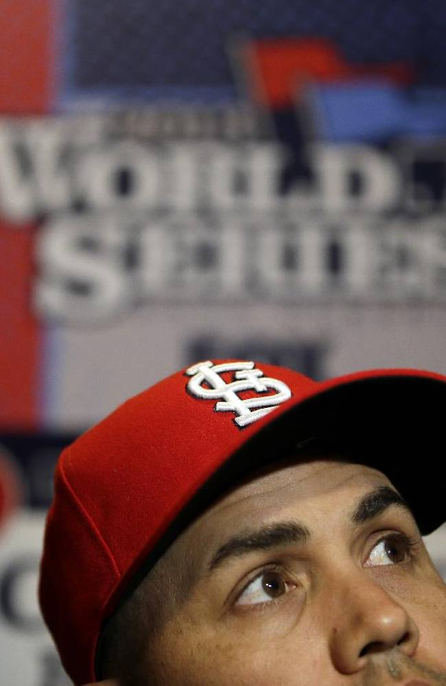 St. Louis Cardinals' Carlos Beltran answers questions during a media availability for Game 1 of baseball's World Series against the Boston Red Sox Tuesday, Oct. 22, 2013, in Boston