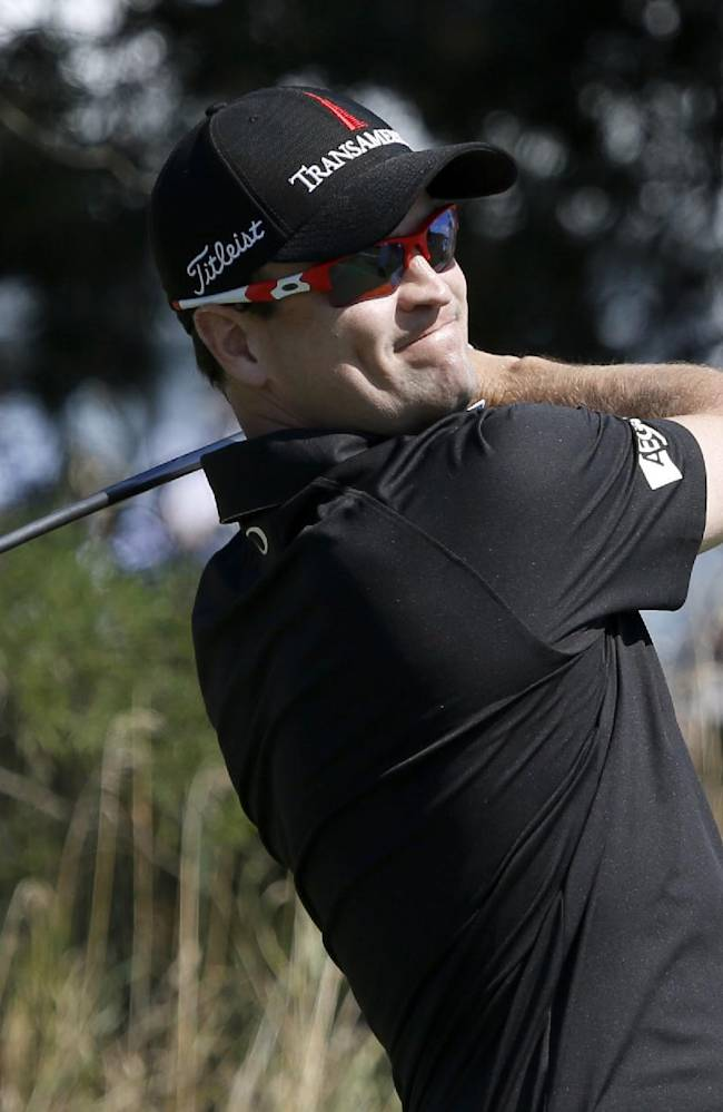 Zach Johnson tees off on the 14th hole during the first round of the BMW Championship golf tournament at Conway Farms Golf Club in Lake Forest, Ill., Thursday, Sept. 12, 2013