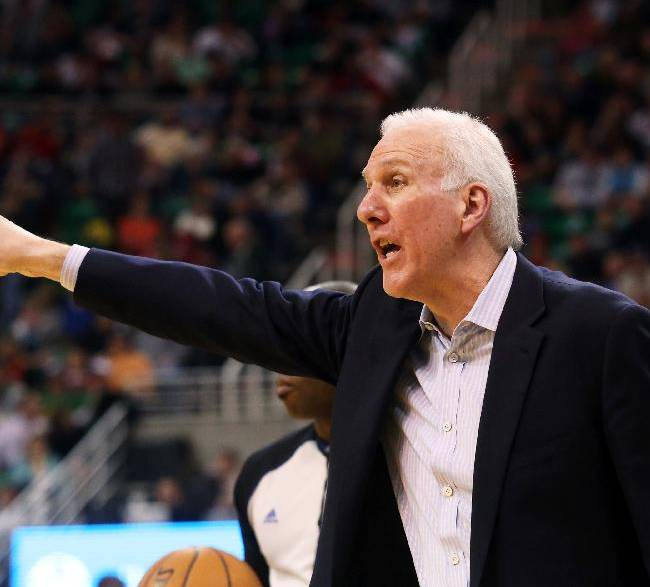 San Antonio Spurs' head coach Gregg Popovich yells from the sidelines in the second half of an NBA basketball game against the Utah Jazz on Saturday, Dec. 14, 2013, in Salt Lake City. San Antonio won the game 100-84