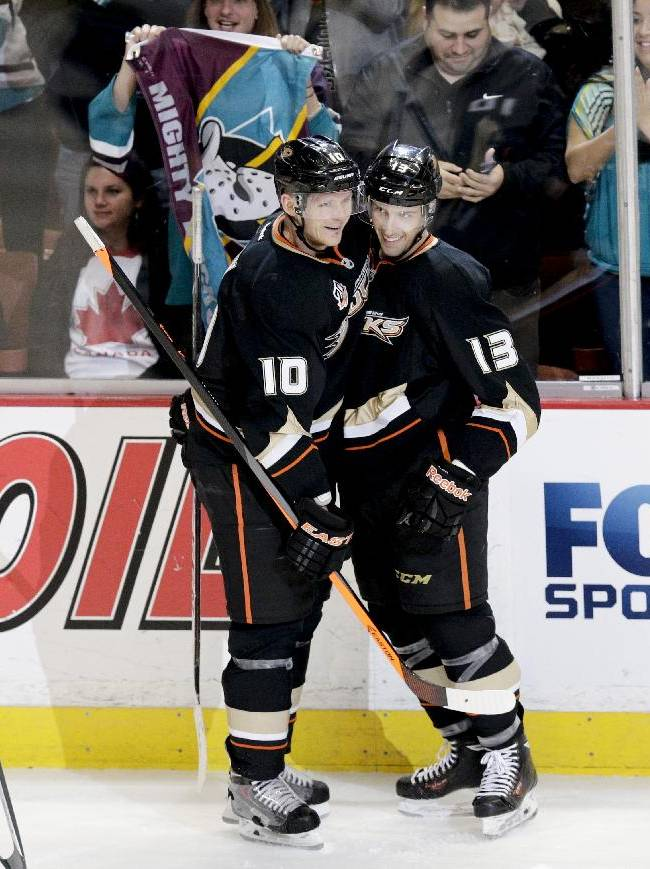 Anaheim Ducks' Nick Bonino(13) celebrates his goal with Corey Perry(10) during the second period of an NHL hockey game against the Vancouver Canucks on Wednesday, Jan. 15, 2014, in Anaheim, Calif