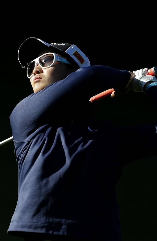 Xi Yu Lin of China plays on the 13th hole during the first round of the Evian Championship women's golf tournament in Evian, eastern France, Friday, Sept. 13, 2013