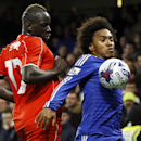 Chelsea's Willian, right, keeps the ball from Liverpool's Mamadou Sakho during the English League Cup semifinal second leg soccer match between Chelsea and Liverpool at Stamford Bridge stadium in London, Tuesday, Jan. 27, 2015