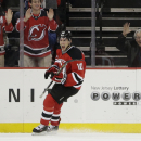 New Jersey Devils defenseman Peter Harrold celebrates after scoring a goal against the Detroit Red Wings during the first period of an NHL hockey game, Friday, Nov. 28, 2014, in Newark, N.J The Associated Press