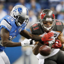 Detroit Lions cornerback Cassius Vaughn (29) deflects a pass intended for Tampa Bay Buccaneers wide receiver Vincent Jackson (83) during the second half of an NFL football game in Detroit, Sunday, Dec. 7, 2014 The Associated Press