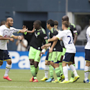 Seattle Sounders players and Tottenham Hotspur players including Tottenham Hotspur's Younes Kaboul, third from left, and Seattle Sounders' Jalil Anibaba (4) tussle during the second half of a friendly soccer match in Seattle, Saturday, July 19, 2014. The