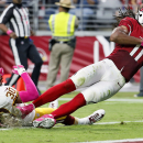 Arizona Cardinals wide receiver Larry Fitzgerald (11) falls into the end zone for a touchdown as Washington Redskins free safety E.J. Biggers (30) defends during the first half of an NFL football game, Sunday, Oct. 12, 2014, in Glendale, Ariz The Associat