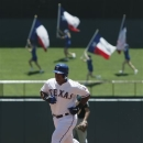Texas Rangers Adrian Beltre (29) rounds the bases after hitting a solo home run in the first inning of a baseball game against the Oakland Athletics in Arlington, Texas, Wednesday, May 22, 2013. (AP Photo/Brandon Wade)