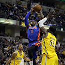 Detroit Pistons forward Josh Smith (6) shoots between Indiana Pacers defenders George Hill (3) and Roy Hibbert (55) during the first half of an NBA basketball game in Indianapolis, Wednesday, April 2, 2014 The Associated Press