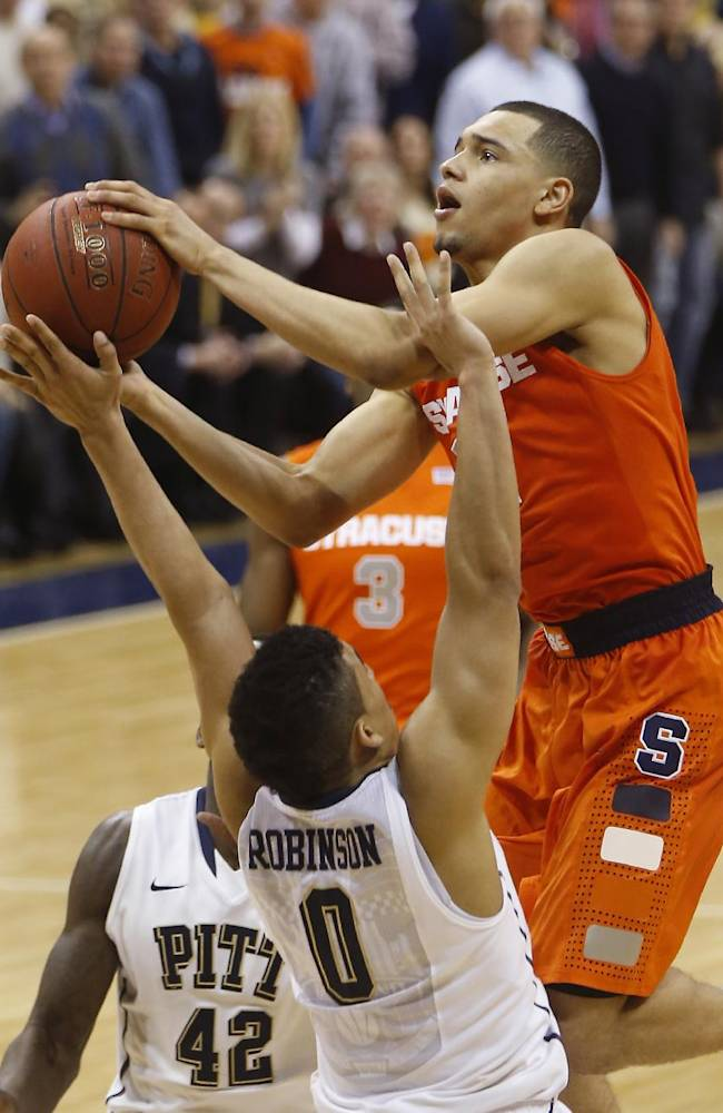 Syracuse's Tyler Ennis shoots over Pittsburgh's James Robinson (0) during the second half of an NCAA college basketball game Wednesday, Feb. 12, 2014, in Pittsburgh. Syracuse won 58-56