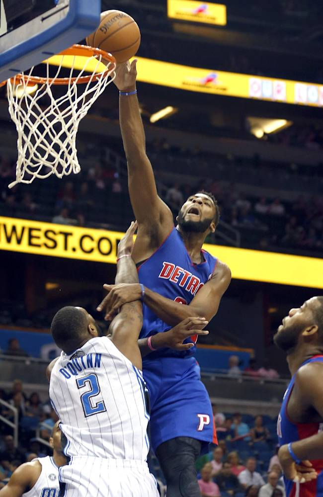 Orlando Magic forward Kyle O'Quinn (2) tries to block the shot by Detroit Pistons center Andre Drummond  during the first half of an NBA basketball game on Sunday,  Oct.  20, 2013 in Orlando, Fla