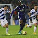 QPR's Joey Barton, left, challenges for the ball with Manchester City's Yaya Toure during the English Premier League soccer match between Queens Park Rangers and Manchester City at Loftus Road stadium in London, Saturday, Nov. 8, 2014