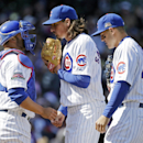 Chicago Cubs' Jeff Samardzija, center, talks with catcher Welington Castillo, left, as first baseman Anthony Rizzo stands near during the sixth inning of a baseball game against the Philadelphia Phillies in Chicago, Saturday, April 5, 2014 The Associated