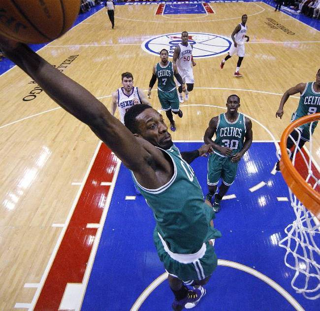 Boston Celtics' Jeff Green goes for the dunk during the first half of an NBA basketball game against the Philadelphia 76ers', Wednesday, Feb. 5, 2014, in Philadelphia