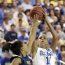 Delaware guard/forward Elena Delle Donne, right, shoots over West Virginia forward Averee Fields during the first half of a first-round game in the women's NCAA college basketball tournament in Newark, Del., Sunday, March 24, 2013. (AP Photo/Patrick Semansky)