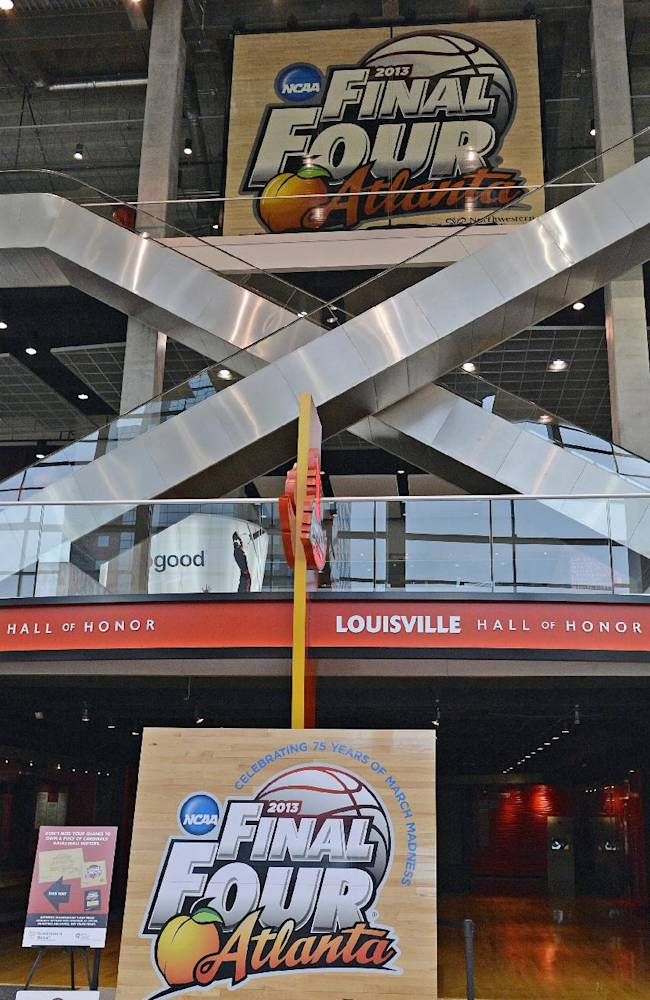 The center section from the 2013 NCAA Championship court was unveiled hanging from the rafters of the KFC Yum! Center before Louisville's NCAA college basketball scrimmage Saturday, Oct. 19, 2013, in Louisville, Ky
