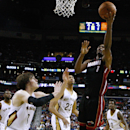 Miami Heat center Chris Bosh (1) shoots over New Orleans Pelicans forward Luke Babbitt, left, during the second half of an NBA basketball game in New Orleans, Saturday, March 22, 2014. The Pelicans won 105-95. Bosh scored 12 points. Babbitt made his first