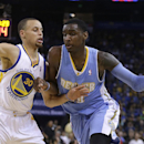 Denver Nuggets' Quincy Miller, right, drives the ball against Golden State Warriors' Stephen Curry (30) during the first half of an NBA basketball game Thursday, April 10, 2014, in Oakland, Calif The Associated Press