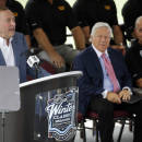 NHL Commissioner Gary Bettman speaks during an event at Gillette Stadium Wednesday, July 29, 2015, in Foxborough, Mass., to promote the NHL Winter Classic hockey game between the Montreal Canadiens and Boston Bruins, scheduled to be played there on New Year's day 2016. Seated are New England Patriots owner Robert Kraft, center, and Bruins owner Jeremy Jacobs, right. (AP Photo/Stephan Savoia)