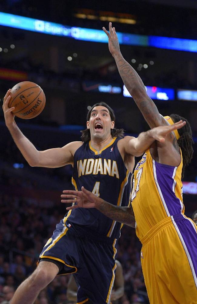 Indiana Pacers forward Luis Scola, left, of Argentina, puts up a shot as Los Angeles Lakers forward Jordan Hill defends during the first half of an NBA basketball game, Tuesday, Jan. 28, 2014, in  Los Angeles