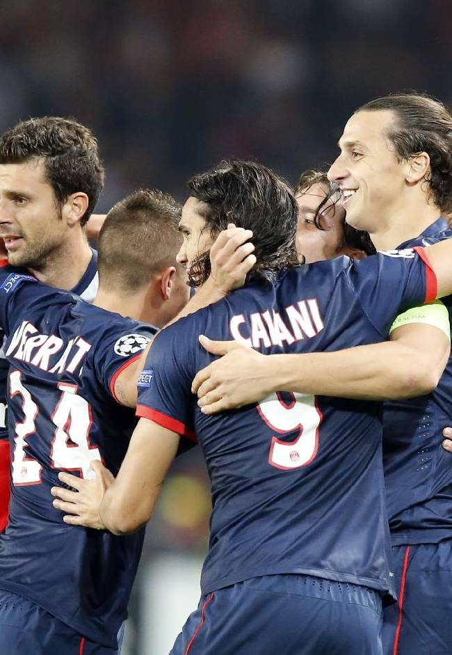 PSG's Zlatan Ibrahimovic, second right, jubilates with teammates after he scored the opening goal during their Champions League group C soccer match between Paris Saint Germain and Benfica at Parc des Princes stadium, in Paris, Wednesday, Oct.2, 2013