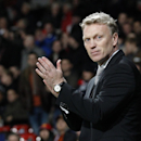 Manchester United's manager David Moyes applauds the fans as he walks back to the technical area at the start of the second half during their Champions League group A soccer match between Manchester United and Shakhtar Donetsk at Old Trafford Stadium, Man