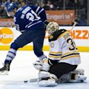 Toronto Maple Leafs left winger James van Riemsdyk screens a shot on Boston Bruins goaltender Chad Johnson during the second period of an NHL hockey game in Toronto on Thursday, April 3, 2014 The Associated Press
